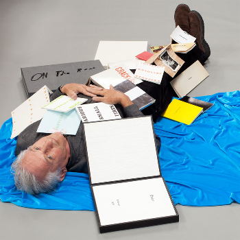 ED RUSCHA with His Books. Photo by Jerry McMillan. Courtesy Craig Krull Gallery © 2012