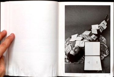 Jerry McMillan: Ed covered with twelve of his books, 1970
