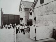Gutai Art Association members in front of Gutai Pinacotheca, Osaka, 1962
