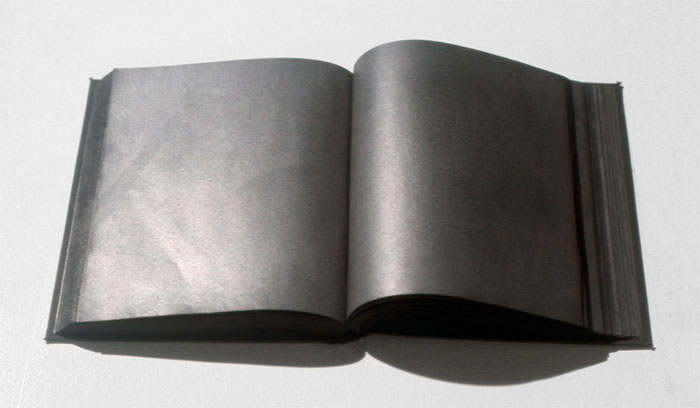 "Ryan Park. untitled (4'33"") Silence by John Cage, rubbed and buffed with graphite from cover to cover. 2006. Collection of the Blackwood Gallery, University of Toronto Mississauga."
